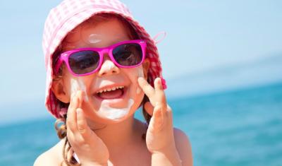 Child Applying Sunblock