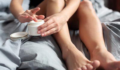 Person Moisturizing Arms and Legs